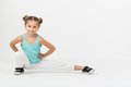 A girl makes gymnastic exercise sitting with hands on belt Royalty Free Stock Photography
