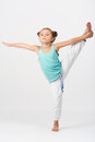 A girl makes gymnastic exercise standing on one leg Royalty Free Stock Photos