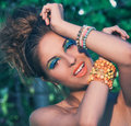 Girl with makeup and handmade bracelets a portrait of a posing beautiful artistic colorful Royalty Free Stock Images