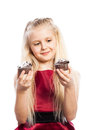 Girl making a choice between two cakes isolated on white background Royalty Free Stock Images
