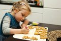 Girl making gingerbread cookies for Christmas Royalty Free Stock Photo