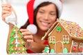 Girl making gingerbread house Stock Image