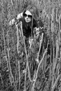Girl making her way through bushes Royalty Free Stock Images