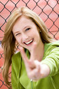 Girl Making Peace Sign Royalty Free Stock Image
