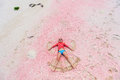 Girl making sand angel Royalty Free Stock Photo