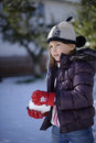 Girl making snowball young in winter coat Royalty Free Stock Photography