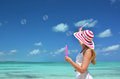 Girl making soap bubbles on the beach Royalty Free Stock Photo