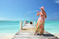 Girl making soap bubbles exuma bahamas on the wooden jetty Stock Photo