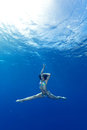 Girl making yoga in the sea athletic Royalty Free Stock Images