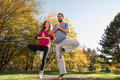 Girl and man doing yoga meditation Royalty Free Stock Photography
