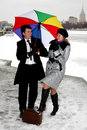 Girl and man with umbrella Stock Photos