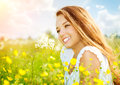 Girl in the meadow beauty lying on green grass Stock Images
