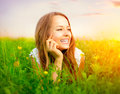 Girl in the meadow beauty lying on green grass Stock Photos
