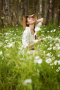 Girl in the meadow of daisies beautiful Royalty Free Stock Image