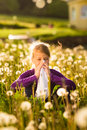 Girl in meadow and has hay fever or allergy Royalty Free Stock Photo