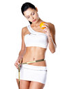 Girl measures figure with a measuring tape and holding orange the healthy lifestyle cocnept Royalty Free Stock Photos