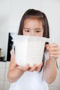 Girl with measuring cup little cute holding milk in a mug Royalty Free Stock Image