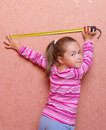 Girl with measuring tape Royalty Free Stock Photography