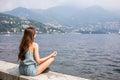 Girl Meditating By The Lake