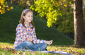 Girl meditating in the park Stock Photo