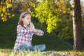 Girl meditating in the park Royalty Free Stock Images