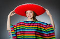 The girl in mexican vivid poncho against gray Royalty Free Stock Photo