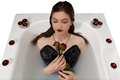 Girl milk water bath red roses candles Royalty Free Stock Photo