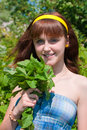 The girl with a mint bouquet Royalty Free Stock Photo