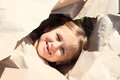 Girl with missing teeth in paper head of little watching thru Royalty Free Stock Image