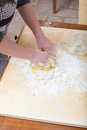 Girl is mixing by hand the water, flour and an egg Royalty Free Stock Photo