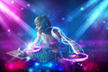 girl mixing music with powerful light effects