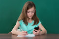 Girl With Mobile Phone And Books Royalty Free Stock Photo