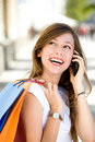 Girl with mobile phone and shopping bags Royalty Free Stock Photo