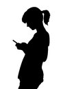 Girl with mobile phone silhouette Stock Photo