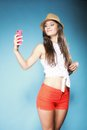 Girl with mobile phone taking photo of herself happy smiling summer smartphone Royalty Free Stock Image