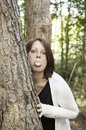 Girl mocking tree behind nature and people Royalty Free Stock Photo