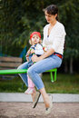 Girl with mom Stock Images