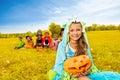 Girl in monster costume holds Halloween pumpkin Royalty Free Stock Photo