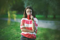 Girl with morning coffee in park Royalty Free Stock Photo