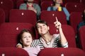 A girl with mother at the cinema Royalty Free Stock Images