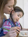 Girl and mother coloring book at home cute together Royalty Free Stock Photography