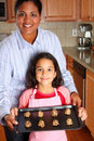 Girl And Mother With Cookies Stock Image