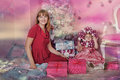 Girl and mother near christmas fir tree with gifts Stock Photos