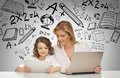 Girl and mother with tablet and laptop education technology internet parenting concept Stock Images