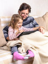 Girl and mother using tablet on sofa Royalty Free Stock Photo