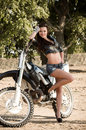 Girl with motorbike Royalty Free Stock Photos
