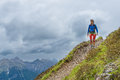 Girl mountain trail walks alone Royalty Free Stock Photo