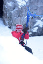 The girl in the mountaineering gear coming down on a rope to cave winter Stock Images