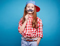 Girl with moustache charming holding on a stick like she is man Stock Photography