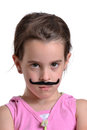 Girl moustache playing dress up with a Royalty Free Stock Photography